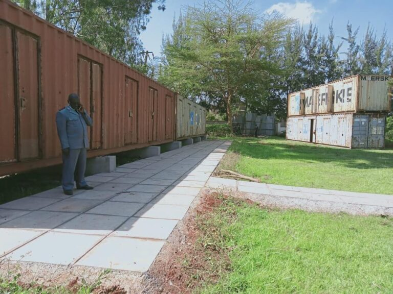 Containers placed on foundations and pathways set