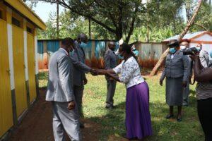 1- Commissioner Stephen Cepkurui greeted by the Head Teacher